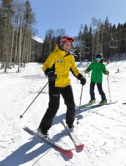 Snowschool instructor and student on rental equipment